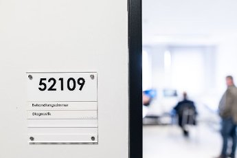 """12 August 2020, North Rhine-Westphalia, Attendorn: On a sign next to an open door at the Attendorn prison it says """"Behandlungszimmer Diagnostik"""". North Rhine-Westphalia\'s Minister of Justice, Biesenbach, will present the current telemedicine pilot project in prisons. Thanks to digital technology, prisoners can access medical care outside office hours and within prison walls around the clock with live transmissions. Seven of the 36 prisons in NRW are taking part in the pilot project. Photo: Fabian Strauch\/dpa"""