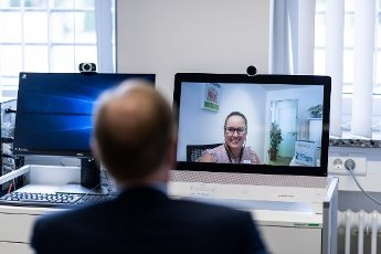 12 August 2020, North Rhine-Westphalia, Attendorn: Peter Biesenbach (CDU, front), Minister of Justice of North Rhine-Westphalia, is sitting in front of a screen during a telemedicine video conference. Biesenbach presents the current telemedicine pilot project in prisons. Thanks to digital technology, prisoners can access medical care outside office hours and within prison walls around the clock with live transmissions. Seven of the 36 prisons in NRW are taking part in the pilot project. Photo: Fabian Strauch\/dpa