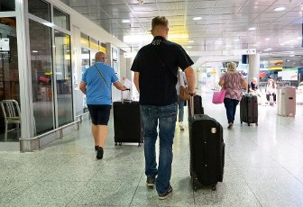 15 August 2020, Lower Saxony, Hanover: Passengers walk through Hannover Airport. Following the classification of almost all of Spain, including Majorca, as a risk area due to high corona figures, the Tui travel group has cancelled all package tours to this destination as of Saturday. Customers will be offered rebookings to other destinations, for example the Canary Islands, says a Tui spokesman. Photo: Peter Steffen\/dpa