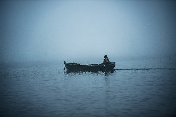 01 October 2020, Berlin: A fisherman is sailing in the thick fog on the Wannsee. Photo: Paul Zinken\/dpa-Zentralbild\/dpa