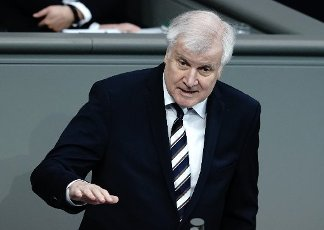 01 October 2020, Berlin: Horst Seehofer (CSU), Federal Minister of the Interior, for Building and Homeland Affairs, speaks to the members of parliament in the Bundestag. The subject of the session is the Federal Government\'s draft bill for the 2021 budget law. Photo: Kay Nietfeld\/dpa