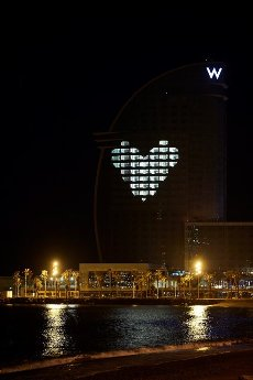 A view of W Hotel illuminated with a big white hearth as a tribute to all health workers working non stop to refrain coronavirus pandemic, in Barcelona, Catalonia, Spain, 28 March 2020. EFE/Alejandro Garcia