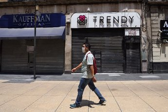 A man walks in front of commercial premises that remain closed, in Mexico City, Mexico, 1 April 2020. Many of the merchants in the center of Mexico City are reluctant to close and stay home when asked by the authorities to prevent the spread of the coronavitus, although some businesses have already closed their doors. EFE/Sashenka Gutiérrez