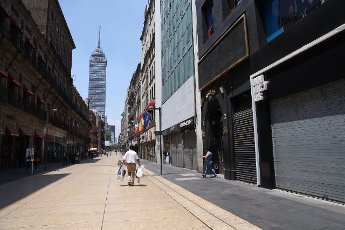 Several commercial premises remain closed, in Mexico City, Mexico, 1 April 2020. Many of the merchants in the center of Mexico City are reluctant to close and stay home when asked by the authorities to prevent the spread of the coronavitus, although some businesses have already closed their doors. EFE/Sashenka Gutiérrez