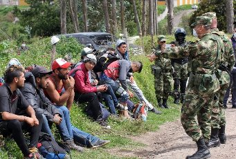 Soldiers requesting documents from Venezuelan, Argentine, Uruguayan and Peruvian citizens who passed from Ecuador to Colombia in Altamira, Colombia, 04 April 2020 (Issued 05 April 2020). Colombia