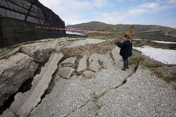 A view of the effects after a landslide next to a big greenhouse in Granada, Andalusia, Spain, 10 April 2020. EFE/Paquet