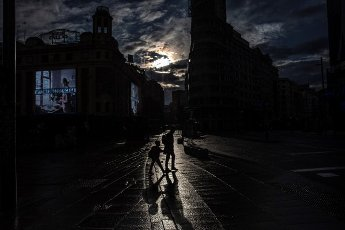 A man with his son walk in Gran Via street in Madrid, Spain ,10 April 2020. Spain faces the 27th consecutive day of mandatory home confinement, on 10 April, in a bid to slow down the spread of the COVID-19 disease pandemic caused by the SARS-CoV-2 coronavirus. EFE/Rodrigo Jimenez