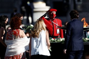 A Navarra\'s regional policeman (2-R) salutes as he pays tribute to COVID-19 victims and people working on the front line to fight the pandemic during a ceremony at Royal Palace\'s courtyard in Madrid, Spain, 16 July 2020. The ceremony was chaired by Spain\'s King Felipe VI. EFE\/Mariscal POOL