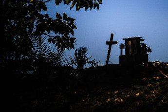 View of a cross in the Flores cemetery where burials are made under the protocols established due to the COVID-19 pandemic, today in Buenos Aires, Argentina 12 August 2020. EFE\/Juan Ignacio Roncoroni