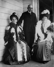 Financier, Hettie Green, built a Wall Street fortune in the Gilded Age. 1909 photo shows her with her newly married daughter, 38 year old Sylvia Green Wilks and her first husband, Matthew Astor Wilks (BSLOC_2018_2_78)