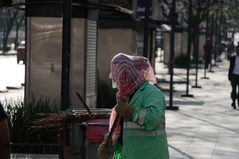 MEXICO CITY, MEXICO -APRIL 10: A woman cleans ground wearing face shield during the lockdown as measure to contain the spread of the SARS-CoV-2 which causes the COVID-19 disease.have confirmed in the country 20 new deaths in 24 hours due Coronavirus On April 10, 2020 in Mexico City, Mexico