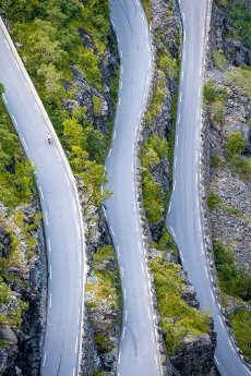 Cyclist on the mountain road Trollstigen, near Åndalsnes, Møre og Romsdal, Vestland, Norway