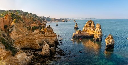 Rugged rocky coast with cliffs of sandstone, rock formations in the sea, Ponta da Piedade, Algarve, Lagos, Portugal