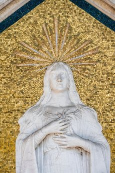 Mary with halo, mosaic with relief, cemetery island San Michele, Venice, Italy