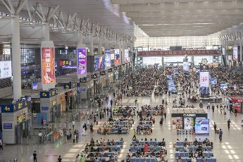 An aerial view of crowd of passengers either sitting or standing in the hall, waiting for trains taking them to different destinations, Shanghai, China, 12 July 2020. Local Caption
