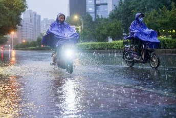 Motor, pedestrians and vehicles trek in the downpour, which might be the biggest downpour of the summer, Beijing, China, 12 August 2020. Local Caption