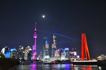 The Bund lights up to celebrate the 71st anniversary of the founding of the People\'s Republic of China. This year, the light show also celebrates the Mid-Autumn Festival, a traditional festival where the full moon symbolizes family reunion for many, Shanghai, China, 30 September 2020
