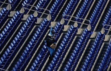 Miami Marlins mascot Billy the Marlin cheers amid empty seats during a game against the Atlanta Braves at Marlins Park in Miami on Friday, Aug. 14, 2020. (David Santiago\/Miami Herald\/TNS