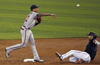 Atlanta Braves infielder Johan Camargo turns a double play over the Miami Marlins\' Matt Joyce during the second inning at Marlins Park in Miami on Friday, Aug. 14, 2020. (David Santiago\/Miami Herald\/TNS