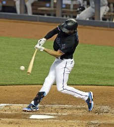 The Miami Marlins\' Matt Joyce singles during the second inning against the Atlanta Braves at Marlins Park in Miami on Friday, Aug. 14, 2020. (David Santiago\/Miami Herald\/TNS