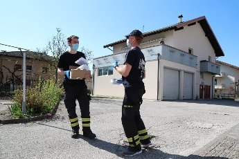 Pierre Teyssot/MAXPPP ; Coronavirus Pandemic - Protective Masks Distribution to the population in Pergine Valsugana, Italy on April 10, 2020. Free Chirurgical Masks delivery at the population in the letter box by the firemen. Wearing a mask is now ...