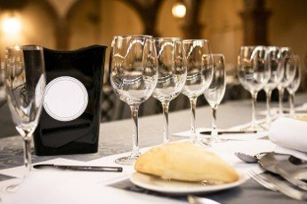Crystal glasses for wine and water on a restaurant event table
