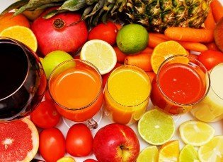 Healthy fruit and vegetable juices on a white background