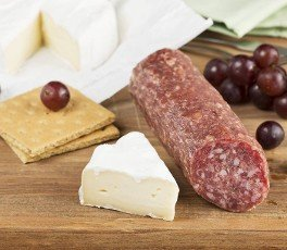 Brie Cheese And Salami On A Wooden Cutting Board