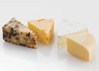 Variety of Cheese Slices On White Background