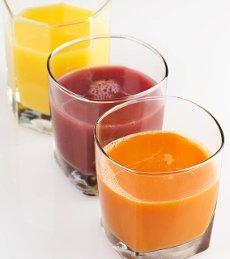 Fresh Fruit And Vegetable Juice on White background