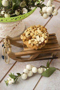 delicious peanut muffins,  winter decoration on white wooden table
