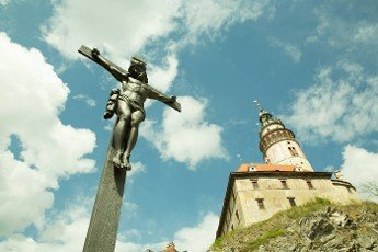 Christ on the cross next to the castle in Cesky Krumlov,  Czech republic,  Europe on a sunny day.