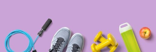 Fitness equipment on a lilac background with copyspace