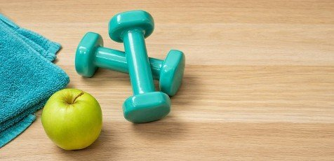 Fitness equipment on a wooden background with copyspace