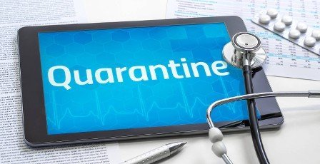 The word Quarantine on the display of a tablet