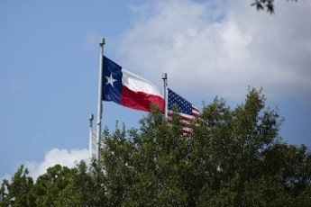 Texas state flag and United States national flag popping in the wind