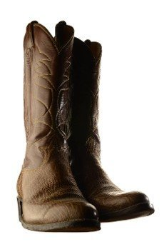 An isolated over white pair of leather cowboy boots.