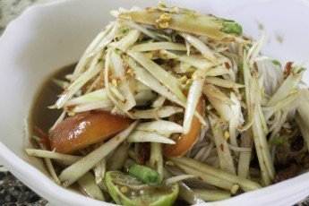 Spicy green papaya salad serve,  stock photo