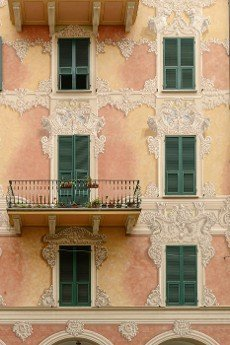 traditional painted facade of old building,   shot at Mediterranean little town of Chiavari,  Genova,  Liguria,  Italy.