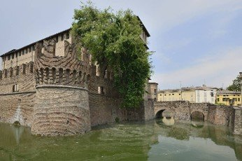 view of entrance bridge of historical fortification completely surrounded by a large moat in the middle of the village,  the picture is shot from north east side..