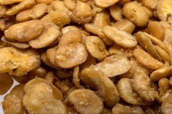Roasted and salted fava beans for a healthy vegan and vegetarian diet snack. High in protein,  vitamins,  dietary fibre and nutrients