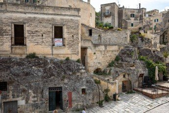 Matera,  Italy - September 20,  2019: View of the Sassi di Matera a historic district in the city of Matera,  well-known for their ancient cave dwellings. Basilicata. Italy