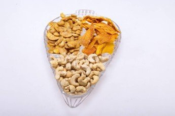 Roasted and salted fava beans,  cashew nuts and dried mango slices for a healthy vegan and vegetarian diet snack. High in protein,  vitamins,  dietary fibre and nutrients
