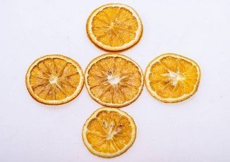 Dried orange slices. Dehydrated crispy fruits for decorating dishes for drinks,  desserts and cocktails.