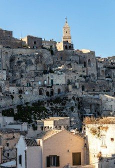 Matera,  Italy - September 14,  2019: View of the Sassi di Matera a historic district in the city of Matera; well-known for their ancient cave dwellings. Basilicata. Italy