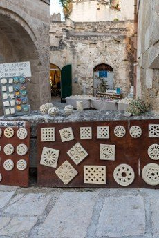 Matera,  Italy - September 15,  2019: Shop with handmade terracotta products in the Sassi di Matera a historic district in the city of Matera. Basilicata. Italy