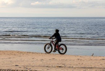 Stegna,  Poland - September 4,  2020: Bike ride along the beach in Stegna. Active and healthy lifestyle.