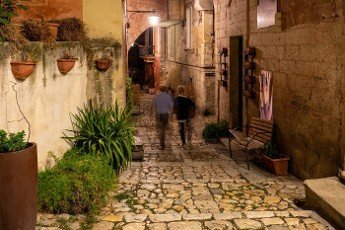 Matera,  Italy - September 19,  2019: Typical cobbled stairs in a side street alleyway iin the Sassi di Matera a historic district in the city of Matera. Basilicata. Italy