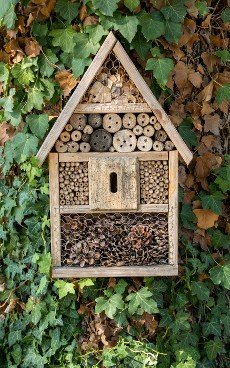 Small wooden house for insects in garden