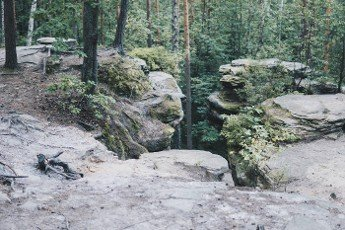 rock formation made from sandstones inside of a forest during summer season in piekielko nature reserve in Poland